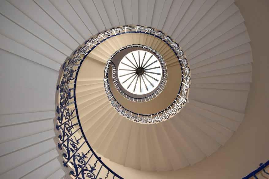 white concrete spiral stairway