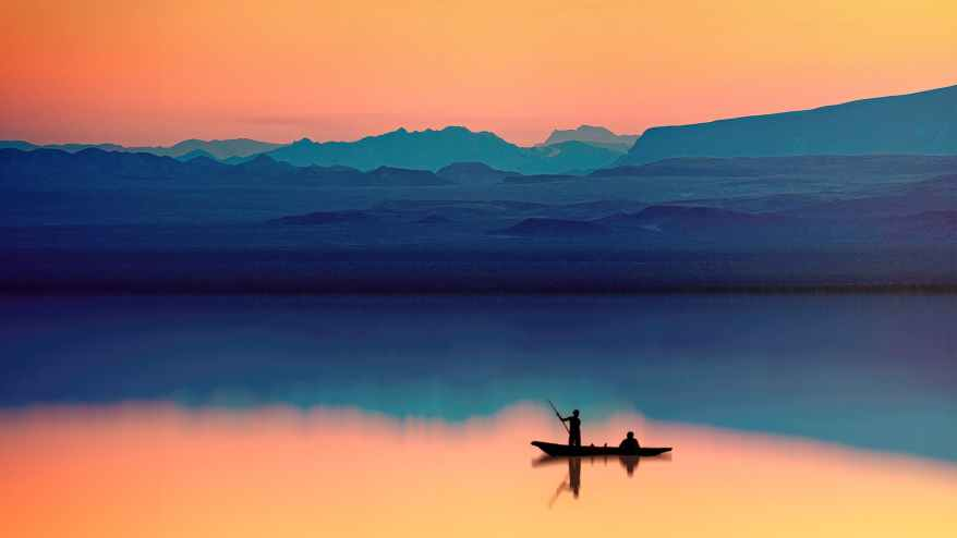 silhouette of person riding boat